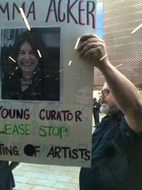 Anti-eviction activists protest at the de Young Museum accusing art curator Emma Acker and her husband Ish Harshawat of evicting an artist from the building they recently purchased in San Francisco, Calif., on Friday, September 4, 2015. The couple is mired in a housing battle with a tenant who refuses to leave despite the couple's family hoping to move into the apartment. Photo: Photos Courtesy Of Ish Harshawat, Special To The Chronicle