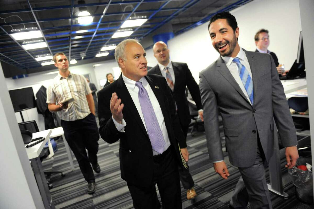Comptroller Thomas P. DiNapoli, center, tours Apprenda Inc. with CEO Sinclair Schuller, right, on Wednesday, Oct. 21, 2015, in Troy, N.Y. The state pension fund has invested $1.2 million in the company through its In-State Private Equity Investment Program. (Cindy Schultz / Times Union)
