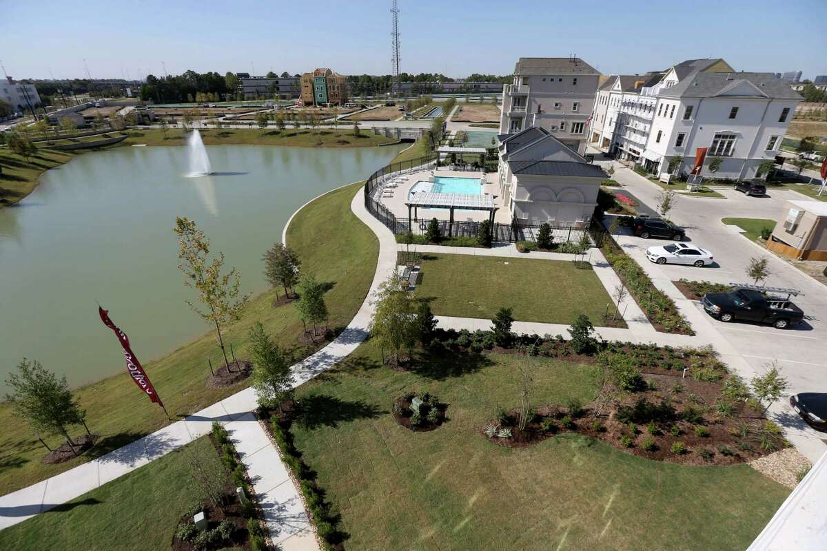 Houston-based Hines is developing Somerset Green, a European style luxury neighborhood built around a canal, Monday, Oct. 19, 2015, in Houston, Texas. The development will have 560 homes from 2,600 to 4,000 square feet, multiple walking trails, two dog parks and an amenity center with swimming pool. Toll Brothers, Coventry Homes and Pelican Builders are the builders. ( Gary Coronado / Houston Chronicle )