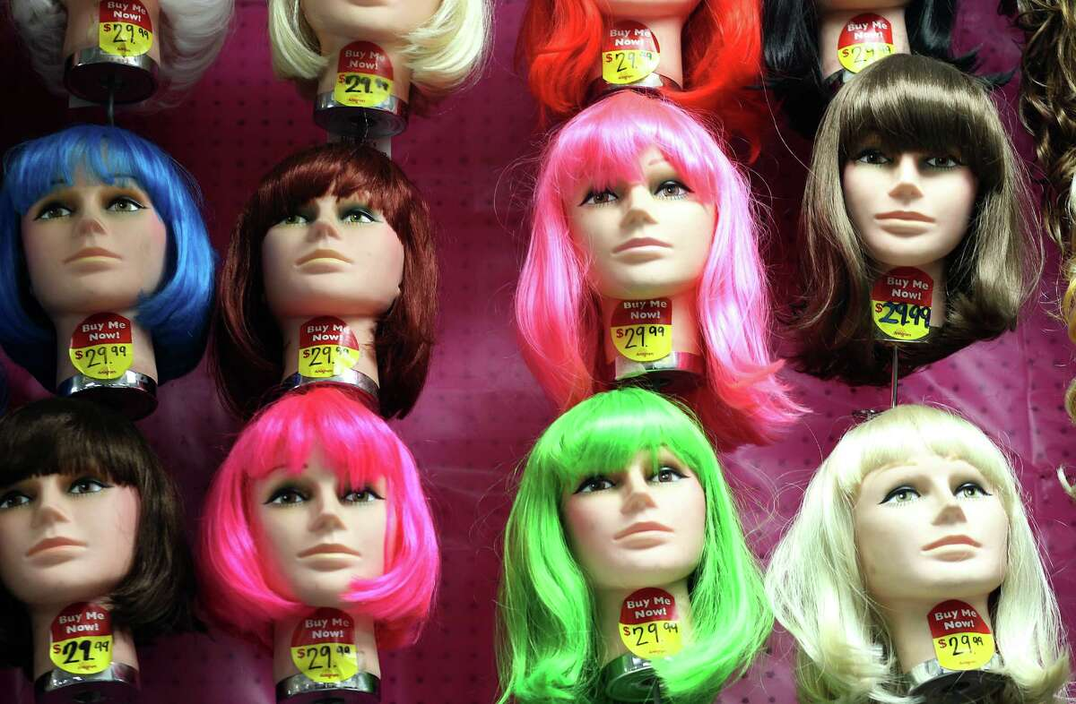 Various colors and styles of wigs adorn a wall at Party Boy, a costume and party supply store that contains everything from decorations to costume rentals to an onsite haunted house, Tuesday, Oct. 20, 2015, in Houston. ( Mark Mulligan / Houston Chronicle )