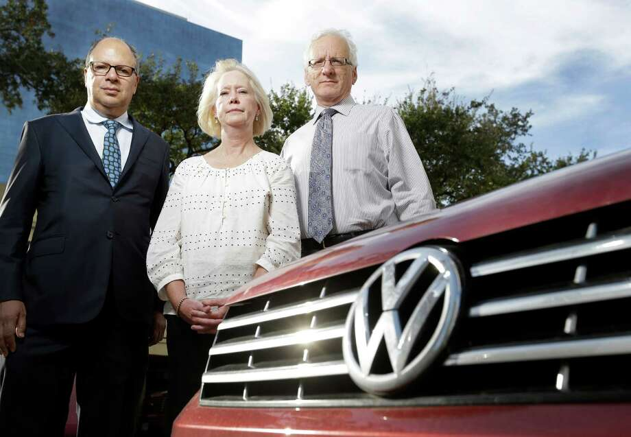 Donna Knowles, with her attorneys Dennis Reich, left, and Richard Schechter, swapped her 2005 Cadillac DeVille for a 2015 Volkswagen Passat. She is joining a class-action suit against the German automaker over the emission problems. Photo: Melissa Phillip, Staff / © 2015 Houston Chronicle