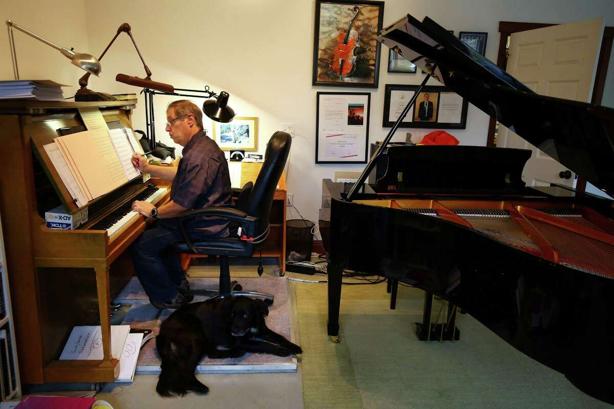 Composer Ron Jones writes music in his new studio in Stanwood, Wa., Tuesday, Oct. 20, 2015. He moved to Stanwood in January from L.A. where he worked on such tv shows as Star Trek: The Next Generation and Family Guy. Jones opened up SkyMuse Studios this year and hopes it will be a place for musicians and composers to collaborate and grow together.