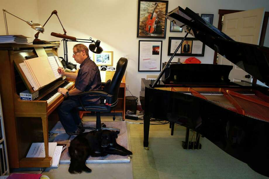 Composer Ron Jones writes music in his new studio in Stanwood, Wa., Tuesday, Oct. 20, 2015.  He moved to Stanwood in January from L.A. where he worked on such tv shows as Star Trek: The Next Generation and Family Guy.  Jones opened up SkyMuse Studios this year and hopes it will be a place for musicians and composers to collaborate and grow together. Photo: GENNA MARTIN, SEATTLEPI.COM / SEATTLEPI.COM