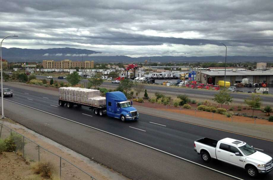 Cars race along a busy section of Interstate 40 in Albuquerque, N.M., Wednesday, Oct. 21, 2015, where police say a 4-year-old girl was shot during an apparent road-rage argument. Albuquerque police are looking for a man in his mid-20s or early-30s who was driving a recent model maroon or dark red Toyota Corolla or Camry with New Mexico license plates in connection to the shooting that occurred on Tuesday, Oct. 20.  (AP Photo/Russell Contreras) Photo: Russell Contreras, STF / AP