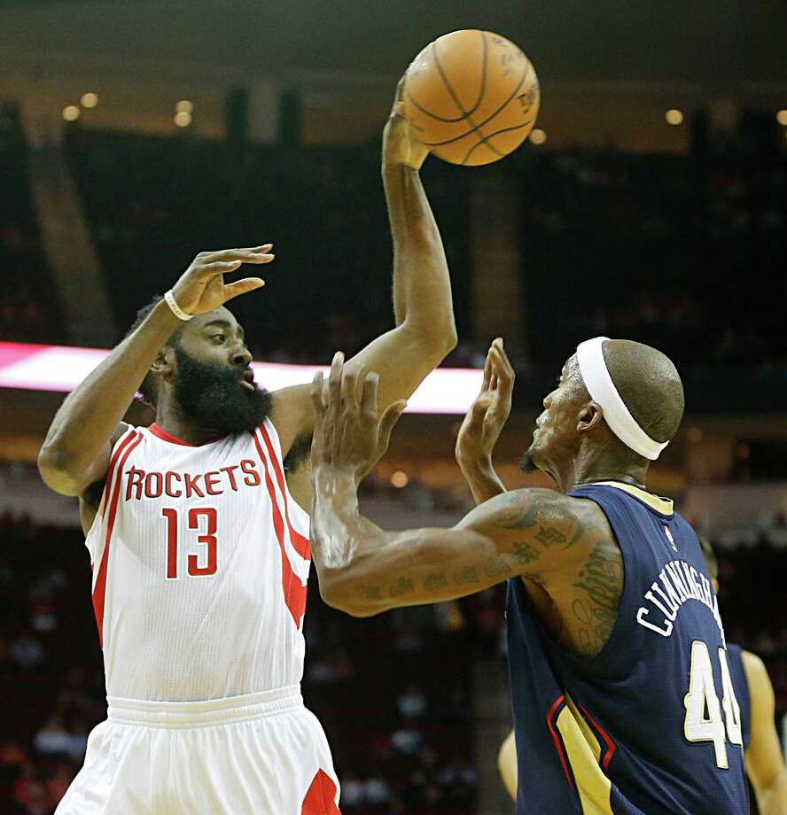 Houston Rockets guard James Harden left, passes over New Orleans Pelicans forward Dante Cunningham right, during the first half of NBA game action at the Toyota Center Monday, Oct. 19, 2015, in Houston.   ( James Nielsen / Houston Chronicle ) Photo: James Nielsen, Staff / © 2015  Houston Chronicle
