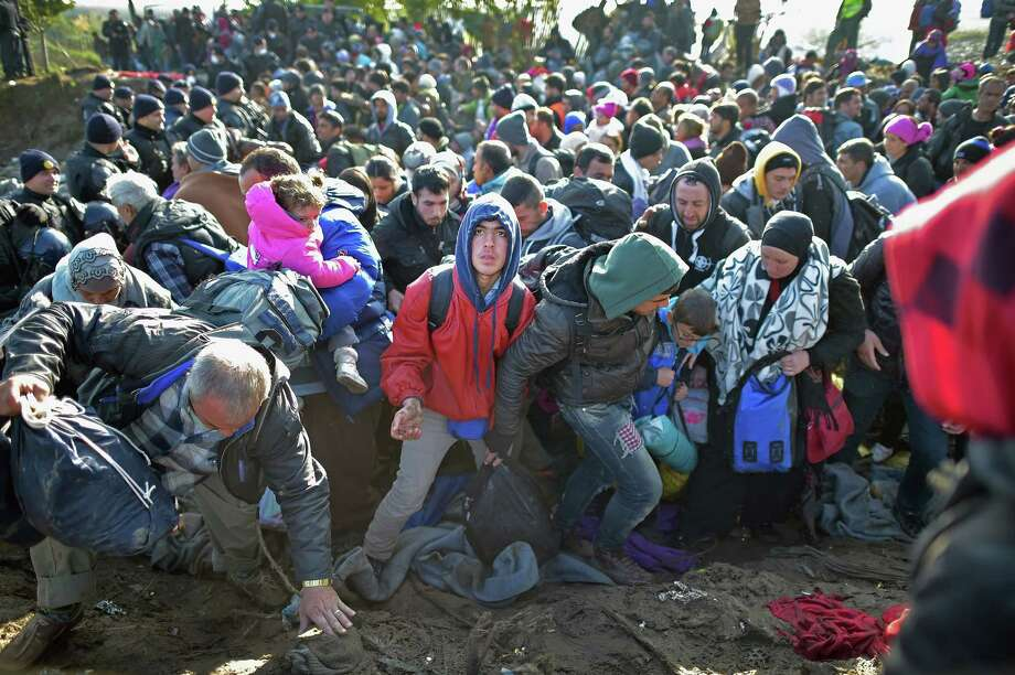 Migrants try to cross the border between Serbia and Croatia near Berkasovo. Tension was building as they remained stranded overnight in cold and wet conditions in the Balkans.  Photo: Jeff J Mitchell, Staff / 2015 Getty Images