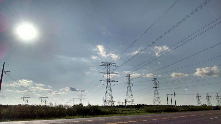 Power lines cross Texas 146 in Galveston County. A study shows Texans are filing fewer complaints about state power providers.  Photo: Bill Montgomery