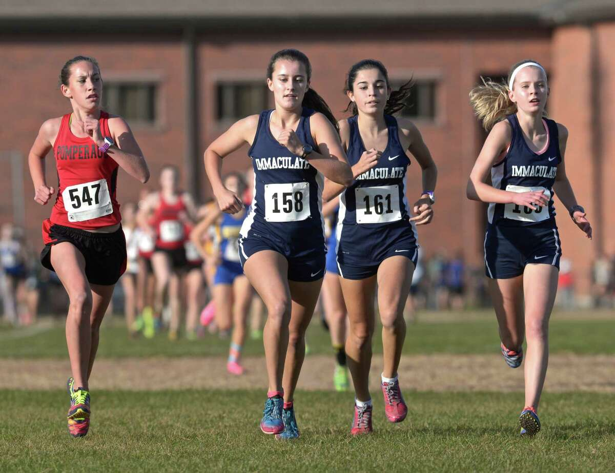 Pomperaug's Ivy Walker (547), and Immaculate's Jenna Gasparrini (158), Danielle Marcone (161) and Angela Saidman (165) lead the pack in the girls SWC cross country championships, on Wednesday afternoon, October 21, 2015, held at Bethel High School, Bethel, Conn.