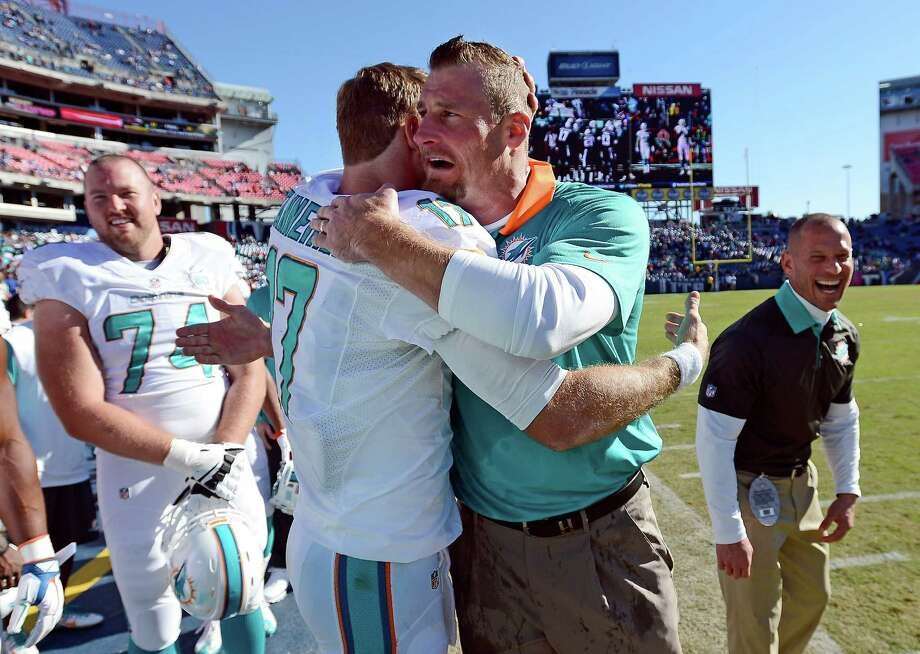 Quarterback Ryan Tannehill likes the boost interim coach Dan Campbell, right, has given the Dolphins, including last week's victory over the Titans. Photo: Mark Zaleski, FRE / FR170793 AP