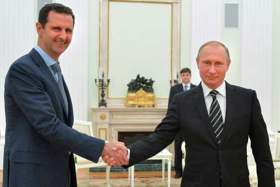 Syria President Bashar Assad traveled Tuesday to Moscow in his first known trip abroad since the war broke out in Syria in 2011 to meet his strongest ally, Russian President Vladimir Putin. The surprise visit could signal that Russia pushed for a political settlement after weeks of airstrikes in Syria. Photo: Alexei Druzhinin, POOL / POOL RIA NOVOSTI KREMLIN