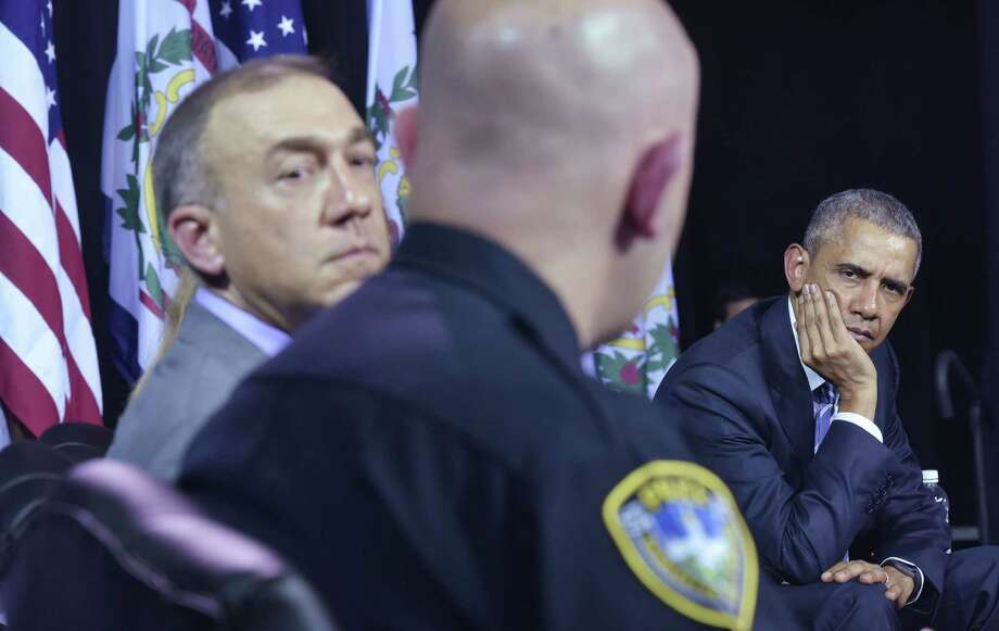 """President Barack Obama listens to a law enforcement officer during a discussion Wednesday on drug abuse at the East End Family Resource Center in Charleston, W.Va. Obama reminded the panel that he """"did some ... stuff"""" as a teenager. Photo: MANDEL NGAN, Staff / AFP"""