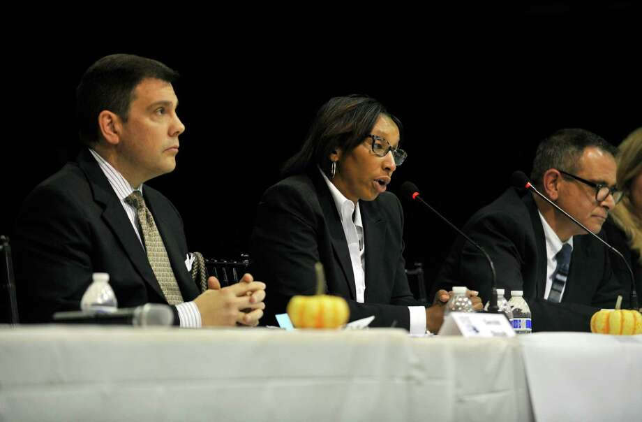 One year Stamford Board of Education candidate Jennienne Burke, center answers a question during the Board of Education candidates forum at the Yerwood Center on Wednesday night, Oct. 21, 2015. Due to several unexpected resignations, there are two one year seats open. Also pictured are Jerry Bosak, left, and John Ciuffo. Photo: Michael Cummo / Hearst Connecticut Media / Stamford Advocate