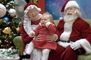 Mrs. Santa is called in to try to quiet a crying Evelyn Zegley, 1 year old from New Fairfield. Glinda and Richard Pennock play Mr. Mrs Santa Claus at the Danbury Fair mall. Photo taken Nov 30, 2008 by Carol Kaliff
