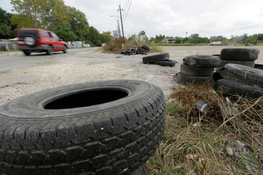 Tires are discarded along Laura Koppe Road at Jensen Street, one of thousands of illegal dumps. Photo: Melissa Phillip, Staff / © 2015 Houston Chronicle