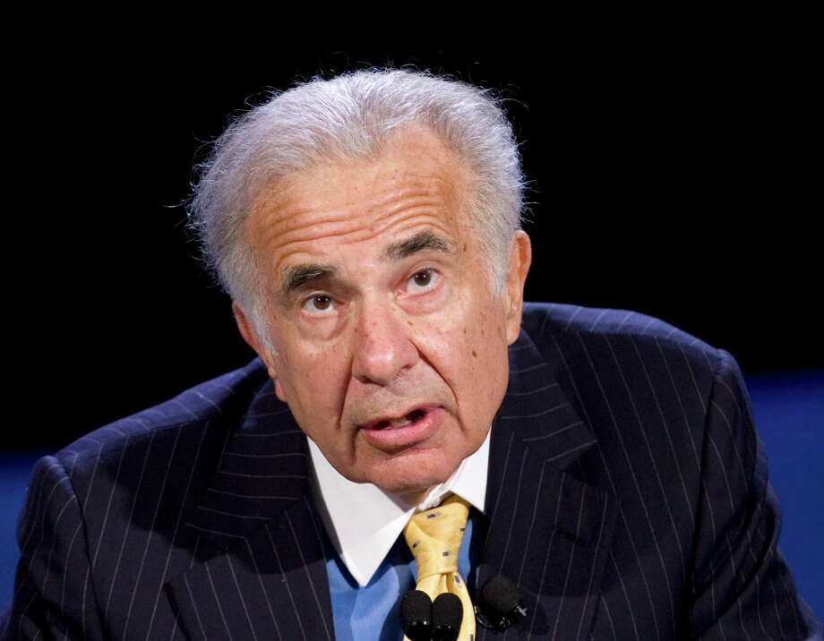 "FILE - In this Oct. 11, 2007 file photo, Carl Icahn speak in New York. Icahn is vowing to create a $150 million super PAC that pushes a corporate tax overhaul. Icahn says in a letter on his website that he wants to press Congress to pass legislation that stops U.S. companies from moving their profits overseas to take advantage of lower tax rates. That practice is known as ""inversions."" (AP Photo/Mark Lennihan, file) Photo: Mark Lennihan, STF / AP"