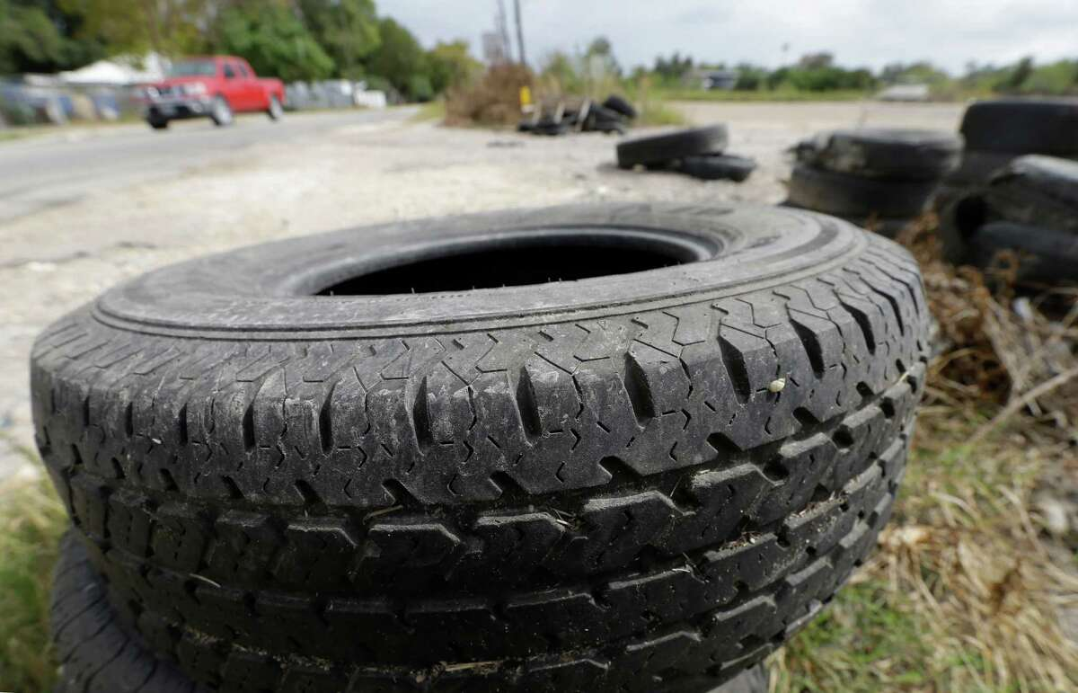 Tires are shown discarded along Laura Koppe Rd. at the intersection of Jensen St. Wednesday, Oct. 21, 2015, in Houston.