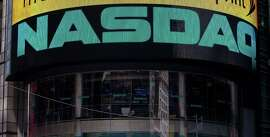 The Nasdaq exchange in Times Square. San Francisco startup SharesPost said Thursday it has sold its stake in Nasdaq Private Market to Nasdaq.