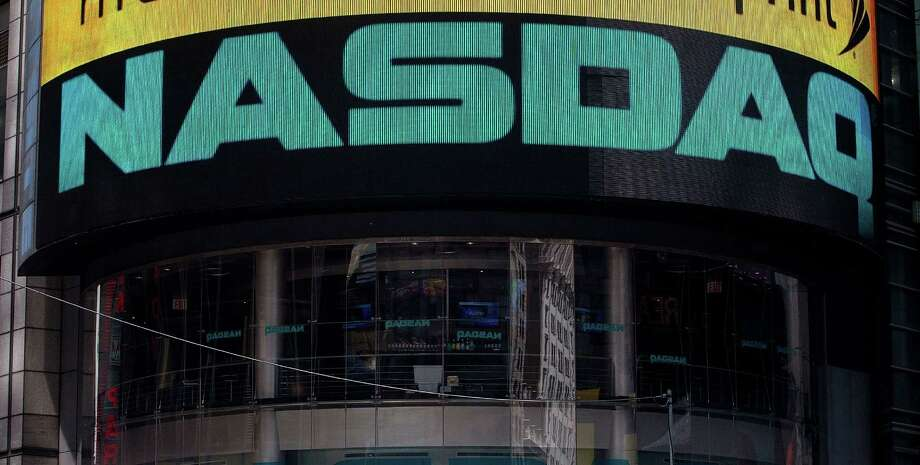 The Nasdaq exchange in Times Square. San Francisco startup SharesPost said Thursday it has sold its stake in Nasdaq Private Market to Nasdaq. Photo: Andrew Burton / Andrew Burton / Getty Images / 2012 Getty Images
