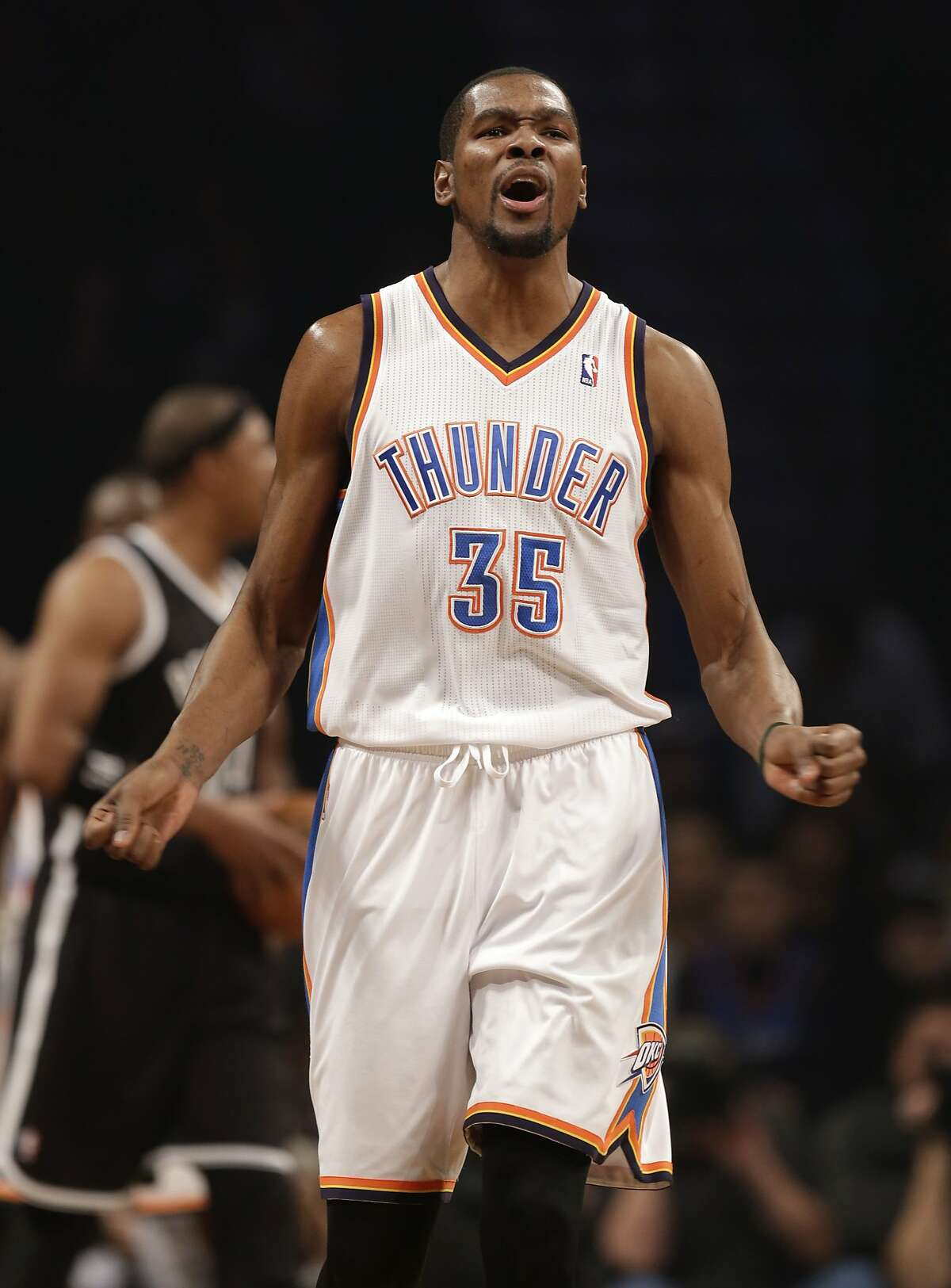 Oklahoma City Thunder's Kevin Durant reacts during the first half of the NBA basketball game at the Barclays Center, Friday, Jan. 31, 2014, in New York. (AP Photo/Seth Wenig)