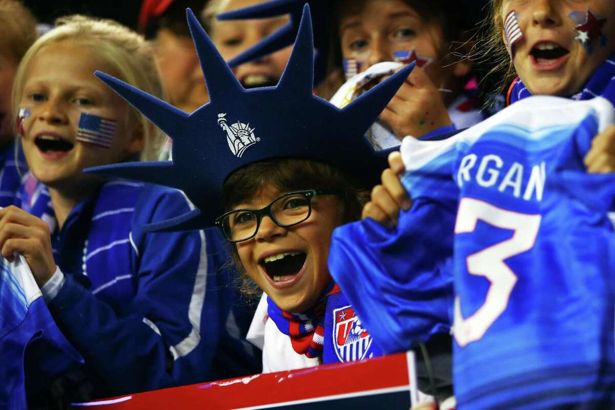 Young fans cheer on their favorite players during the U.S. Women's National Team exhibition game against Brazil at CenturyLink Field, Wednesday, Oct. 21, 2015. The game ended in a 1-1 tie.
