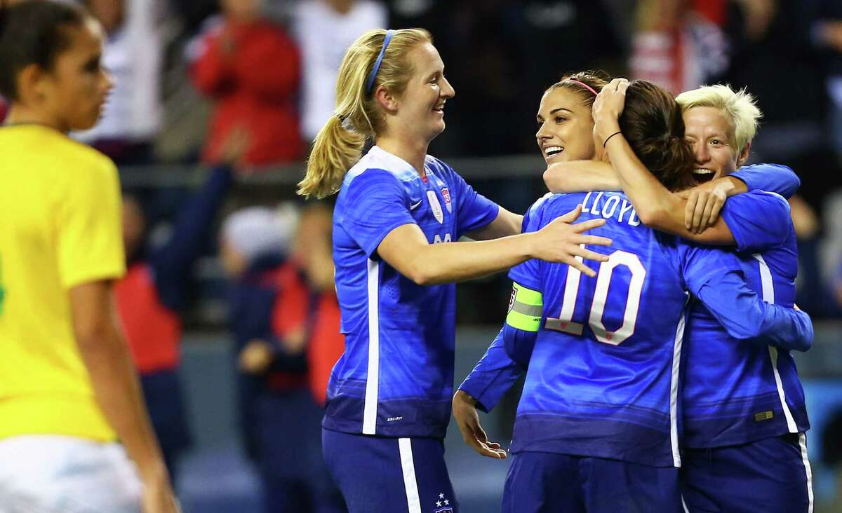 USWNT players (from left) Samantha Mewis, Alex Morgan, Carli Lloyd and Megan Rapinoe celebrate Lloyd's goal late in the second half, which tied up their exhibition game against Brazil at CenturyLink Field, Wednesday, Oct. 21, 2015. The game ended in a 1-1 tie.