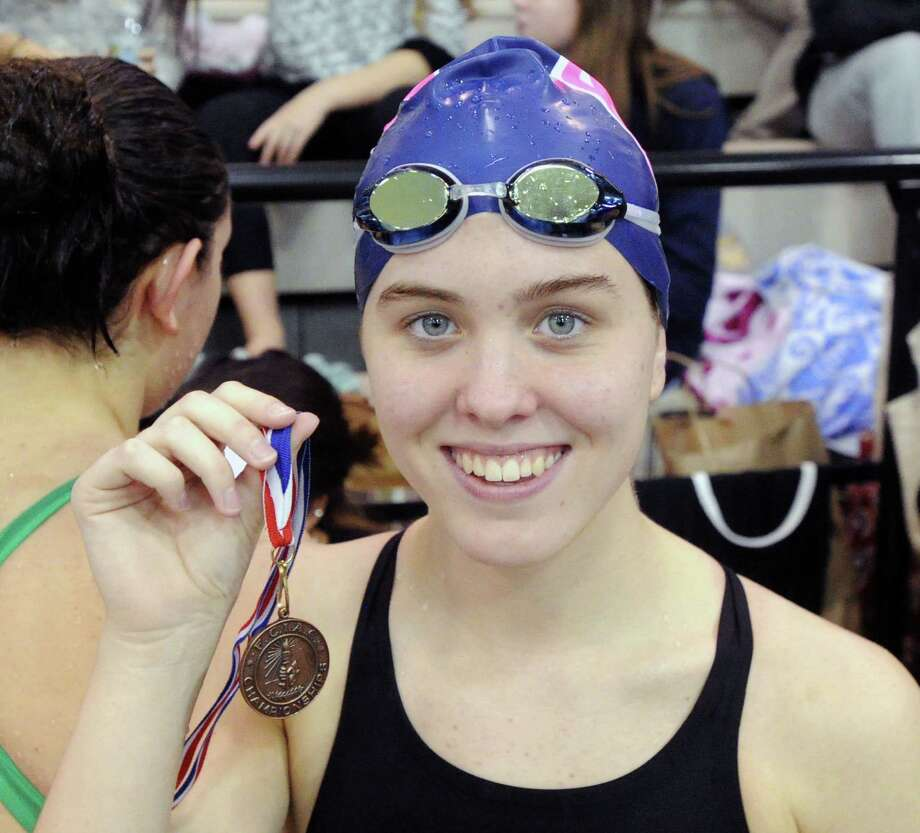 Amelia Bullock of Staples with the first place medal she won for the 200 IM event during the FCIAC Girls High School Swimming Championship at Greenwich High School, Greenwich, Conn., Thursday, Oct. 30, 2014. Darien won the meet taking  the championship over New Canaan, the second place finisher. Photo: Bob Luckey / Bob Luckey / Greenwich Time