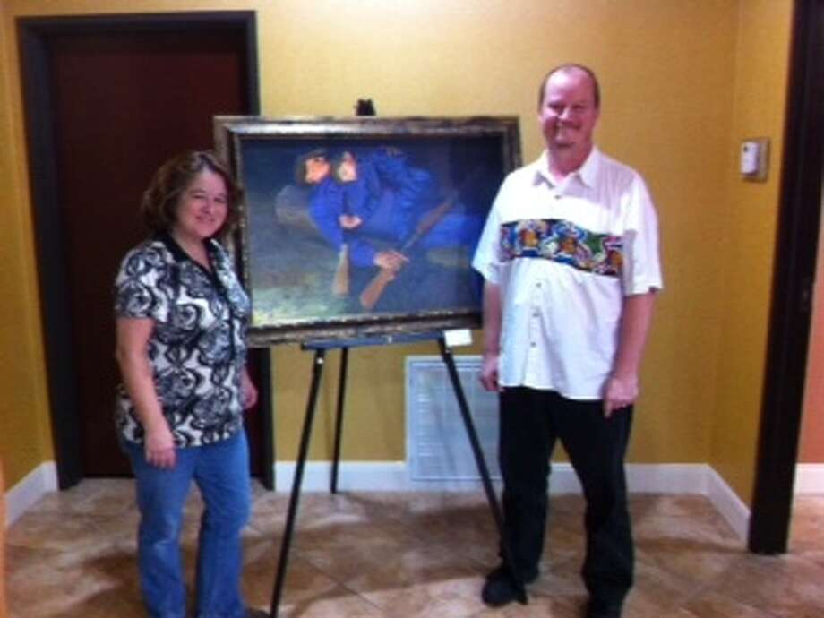 Comfort Suites, 2806 Miller Ranch Road in Pearland,  hosted in October a Pearland Arts League art exhibit by photographer Lisa Slattery and oil painter Michael Slattery. Visit www.pearlandartsleague.com for details. Photo: Pearland Arts League