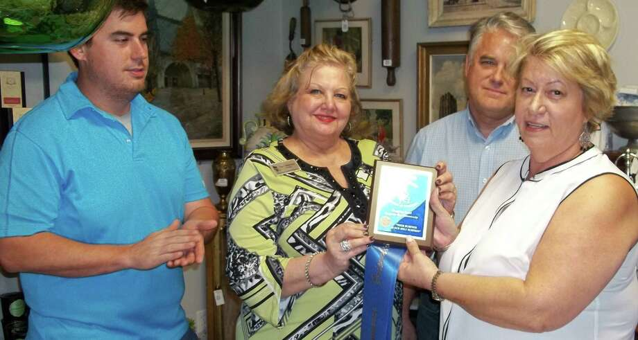 The Friendswood Chamber of Commerce welcomed Marrone Market. From left are Jake Brown; Carol Ives Marcantel, chamber president; Larry Brown and Sharon Brown.  Photo: Friendswood Chamber Of Commerce