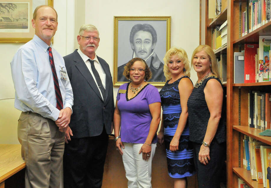 The Jose Miguel Arciniega Descendants Society presents a portrait to the South Campus Library Texana Collection. From left are Richard McKay, library director; David Baisden, artist; Brenda Jones, provost; Donna De Leon, Arciniega descendant; and Ruth Keenan, San Jacinto College Foundation executive director of advancement. Photo: San Jacinto College