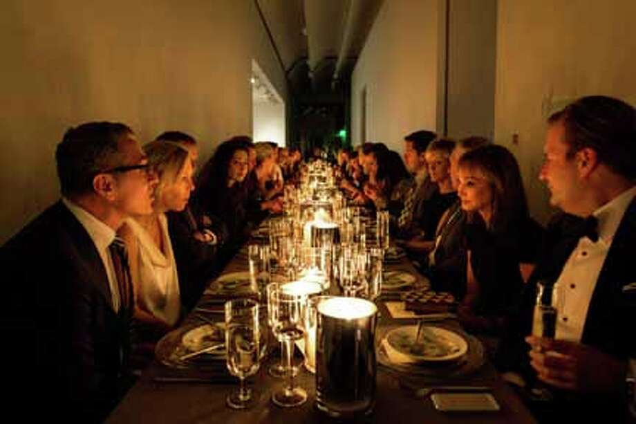 Guests dine with candlelight at the exclusive Tom Ford dinner at the Menil Collection. Photo: Kirsten Gillium