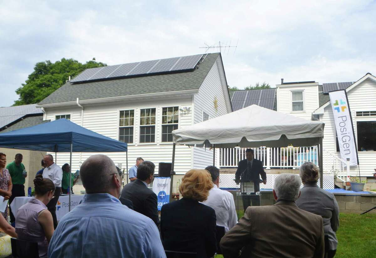 Bryan Garcia, CEO of the Connecticut Green Bank speaks in July 2015 at the home of Susan Young in Bridgeport, Conn., among the first in Connecticut to install solar power and other energy efficiency measures as part of an incentive program partnered by the Connecticut Green Bank and PosiGen.