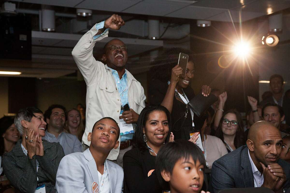 Cedric Brown, chief of community engagement at Kapor Center for Social Impact, cheers with the crowd as The Hidden Genius Project is announced a winner of a $500,000 grant during the Google Impact Challenge award reception, Wednesday, Oct. 21, 2015, in San Francisco, Calif.