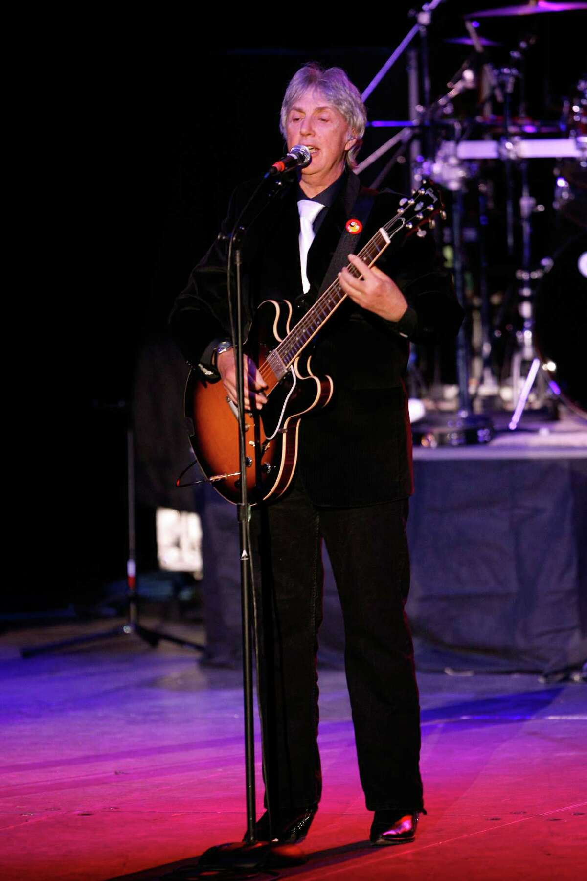 This Dec. 6, 2008 photo provided by Three Dog Night shows singer-musician, Cory Wells, performing on stage with Three Dog Night at Primm Valley Resort, in Primm, Nevada. Wells, a founding member of the popular 1970s band Three Dog Night. Wells died at age 74 on Oct. 20, 2015. (Jerry Gallegos/Three Dog Night via AP)