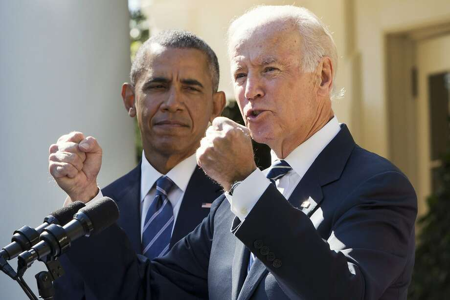 Vice President Joe Biden announces his decision not to seek the presidency at a Rose Garden address with President Obama at his side on Wednesday. Photo: Jacquelyn Martin, Associated Press