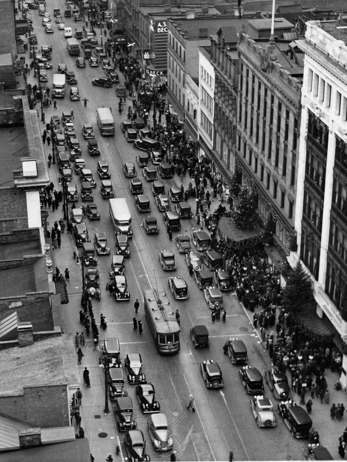 Continue browsing this slideshow to see more historical holiday shopping photos from our archive. Shoppers flock to John G. Myers Department Store on North Pearl Street in Albany during the holiday season in the 1940s.