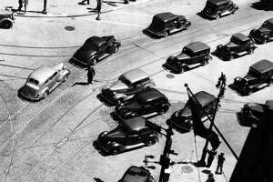 """Albany traffic at State and Broadway, June 1, 1937.   Original caption: """"Everyone seems to be enroute today as Albanians move out of the city for the Memorial Day weekend and visitors move in. The traffic at State and Broadway moved steadily today in both directions forecasting heavier traffic before nightfall and all day tomorrow and Monday.""""   (Times Union Archive)"""