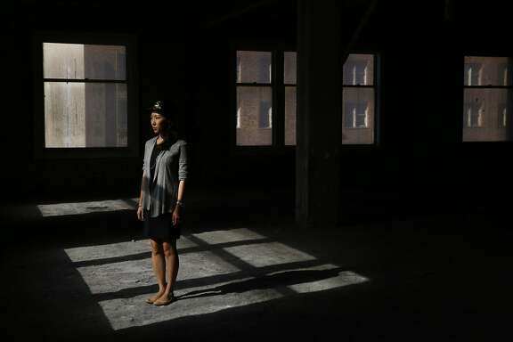 Project manager Janet Lee, of Synapse Development Group, the group overseeing the project at the historic Grant Building and future Yotel branded hotel on mid-Market poses for a portrait at the construction site Oct. 21, 2015 in San Francisco, Calif.