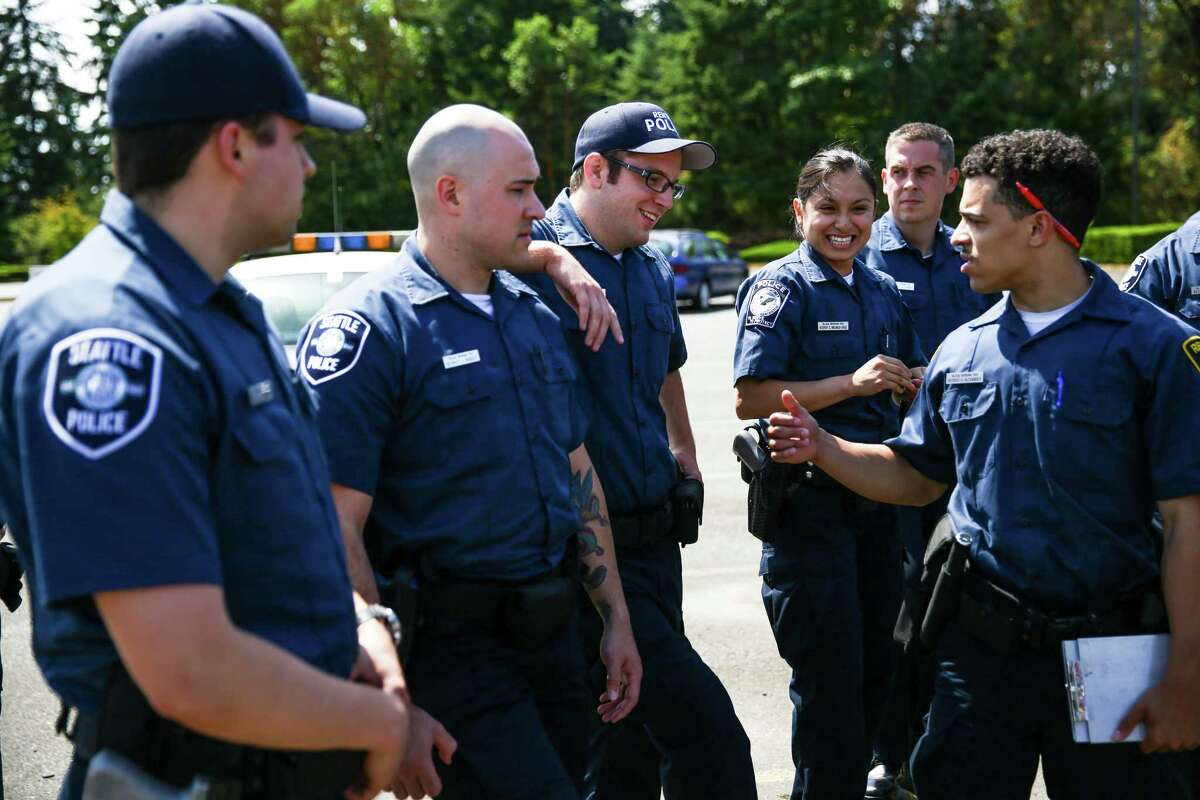 Recruits share a light moment during the Basic Law Enforcement Academy in Burien.Photographed on July 22, 2015.