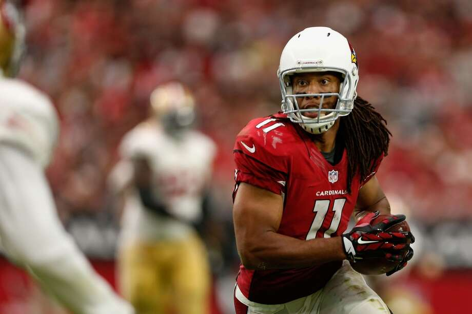 Arizona Cardinals: Larry Fitzgerald, wide receiver   One of the top red-zone targets and all-around wide receivers of the past decade, gets the nod over Hall of Fame cornerback Aeneas Williams and quarterback Kurt Warner. Photo: Christian Petersen, Getty Images