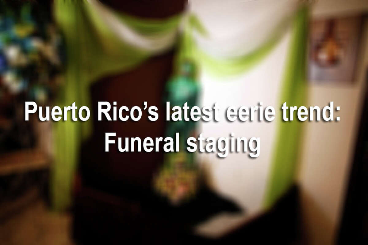 Since 2008, several memorials have gained international attention for having corpses propped and dressed in unusual costumes. In some cases, a man is dressed as superhero The Green Lantern, while another man is mounted on a sports bike. Click through the gallery to view photos of funeral staging in Puerto Rico.