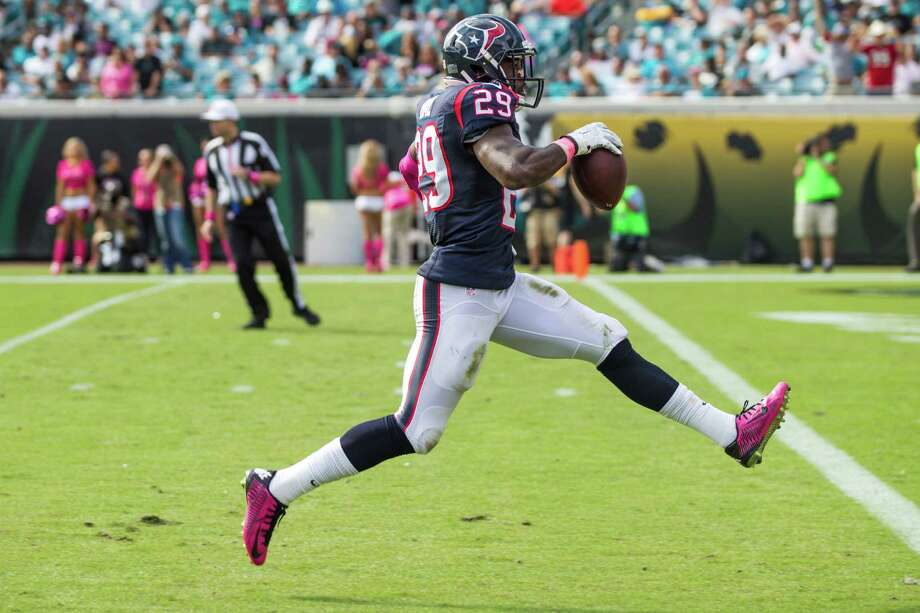 Texans safety Andre Hal strolls into the end zone to complete a 31-yard interception return for a touchdown in Sunday's 31-20 victory over Jacksonville. Photo: Brett Coomer, Staff / © 2015  Houston Chronicle