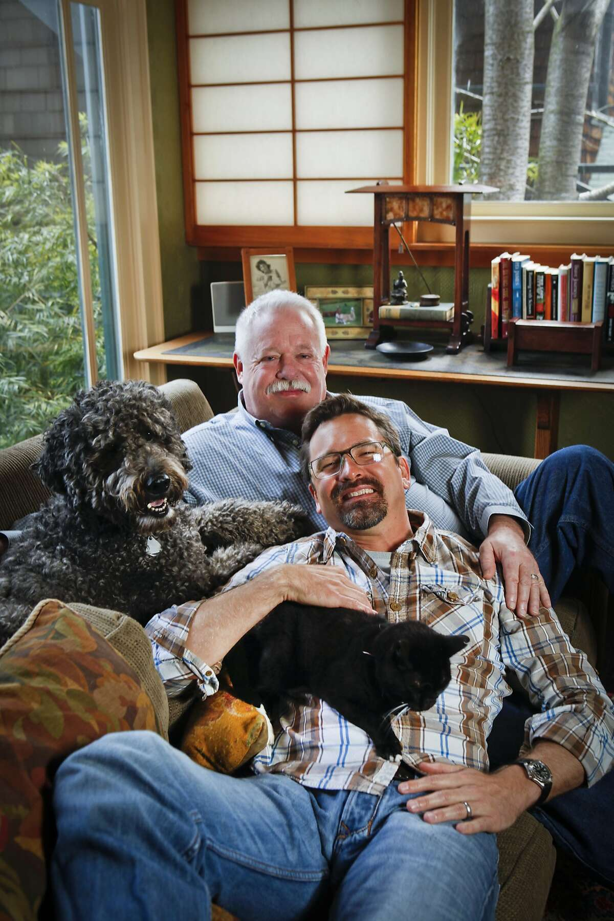 Writer Armistead Maupin and his partner, Christopher Turner, seen on Thursday, April 14, 2011 in their San Francisco, Calif., home, have two pets, a labradoodle named,