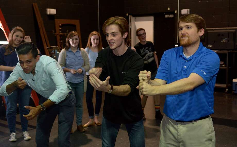 The Woodlands High School Improv Troupe members Omar Saber, 17, from left, and Will Burke, 18, both seniors, work with TWHS Theater Director Matthew Peters during a rehearsal in the school's black box theater on Oct. 21, 2015. (Photo by Jerry Baker/Freelance)4 Photo: Jerry Baker, Freelance