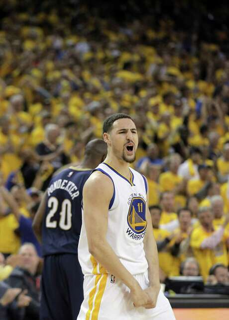 Klay Thompson celebrates after hitting a shot against the New Orleans Pelicans in Game 2 of the Western Conference playoffs at Oracle Arena on April 20. Photo: Carlos Avila Gonzalez / Carlos Avila Gonzalez / The Chronicle / ONLINE_YES