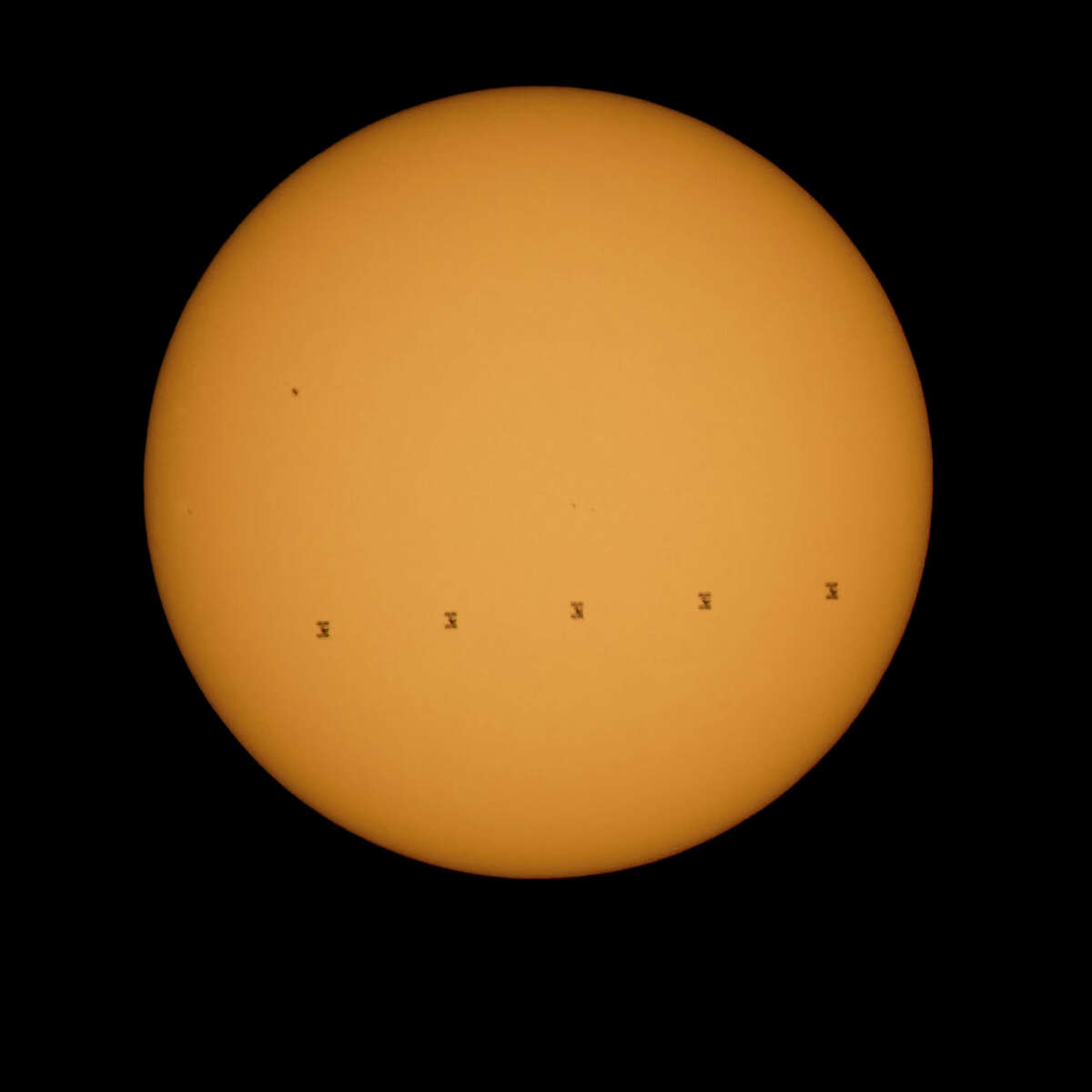 The alien megastructure could be something like our own International Space Station ... just much larger and going around the sun. NASA caption: This composite image made from five frames shows the International Space Station, with a crew of nine onboard, in silhouette as it transits the sun at roughly 5 miles per second, Sunday, Sept. 6, 2015, Shenandoah National Park, Front Royal, VA. (Photo: NASA/Bill Ingalls)