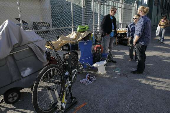 Guiseppe  Galuppo, 53, (left) who has been homeless for the past two years, talks with local merchant Candice Combs and her brother Dave Combs on the corner of Folsom and 16th Street where he is currently living, on Wed. October 21, 2015, in San Francisco, Calif. Canice Combs is president of the Mission Creek Merchants Association.