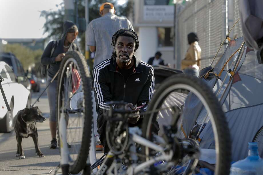 James Lucas who is homeless sits outside his tent on the corner of Folsom and 16th Street where he is currently living in San Francisco. Photo: Michael Macor, The Chronicle
