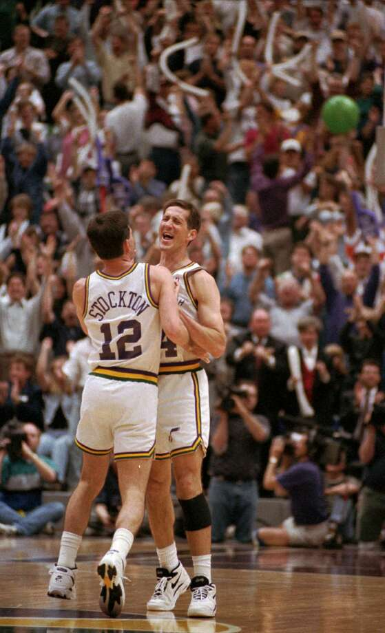 The crowd cheers as Utah Jazz players Jeff Hornacek and John Stockton (12) celebrate Hornacek's three-pointer against the Portland Trail Blazers in the fourth quarter April 25, 1996, in Salt Lake City. The Jazz came back from a 12-point deficit to win 110-102. Photo: DOUGLAS C. PIZAC / DOUGLAS C. PIZAC / Associated Press / AP