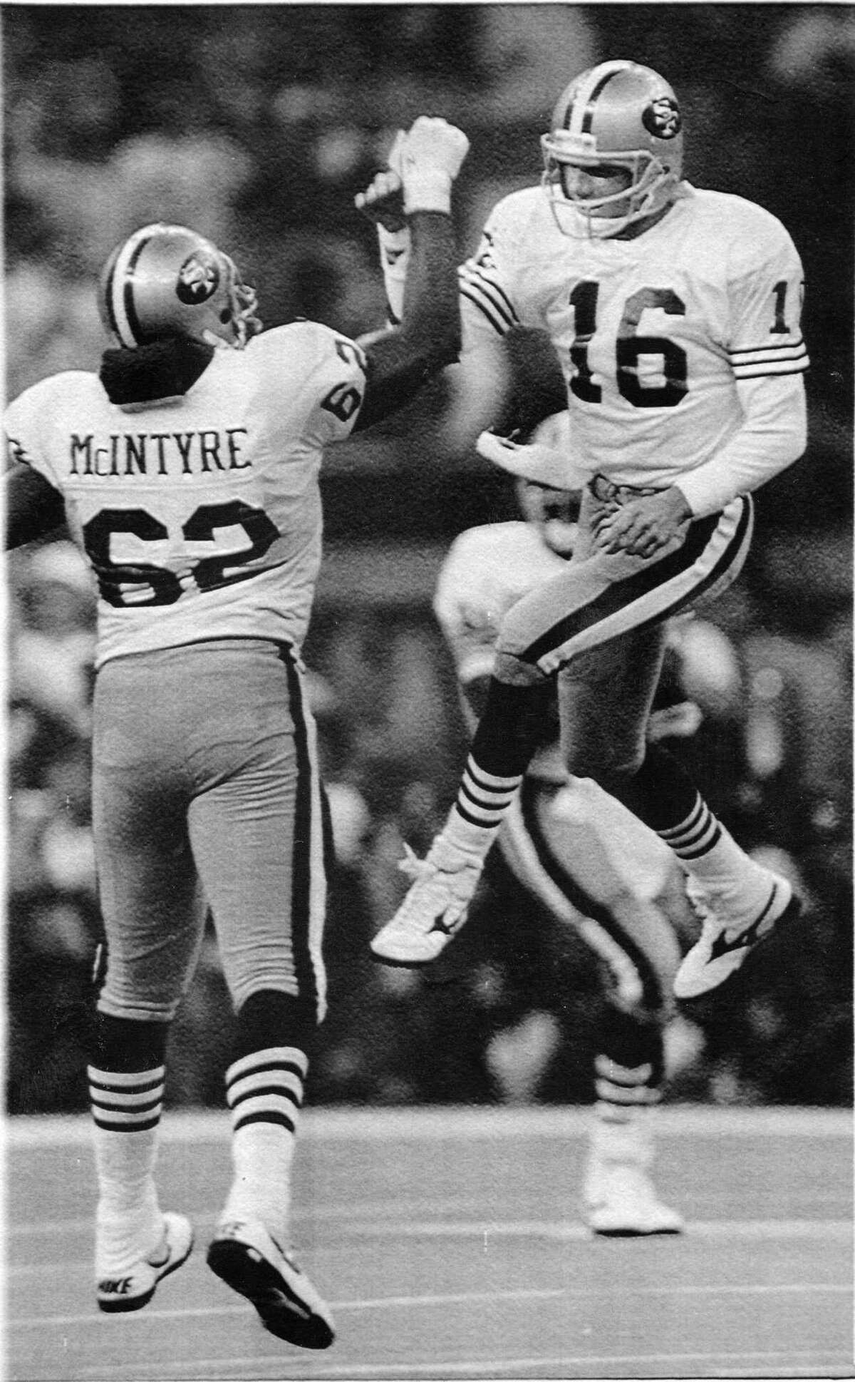Joe Montana celebrates after a touchdown with 49ers teammate Guy McIntyre during Super Bowl XXIV at the Superdome in New Orleans on Jan. 29, 1990.