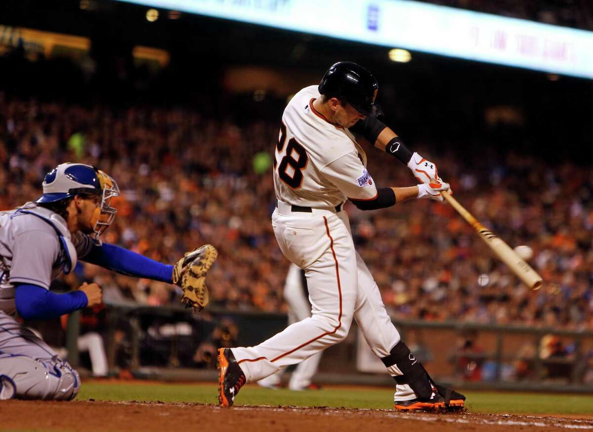Buster Posey hits an RBI single in the third inning against the Los Angeles Dodgers at AT&T Park on April 21.